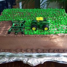 Awesome tractor cake idea.  Instead of tractor taking out grass...have cows grazing instead