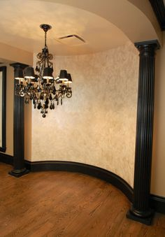 Venetian Plaster with Pearl Overlay by Garay Artisans.  Love the walls, but I want that chandy!!!  I AM IN LOVE LOVE LOVE WITH THIS WHOLE IDEA.... Black Trim, Curve, Chandelier, Paint technique... ALL !!!!!