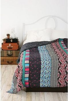 OK, now this is a quilt I could make. Just straight lines :)