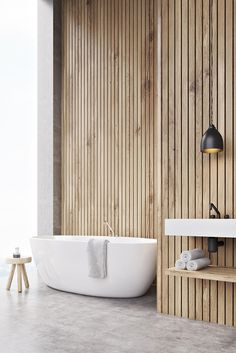 Wooden themed bathroom which creates an interesting contrast, juxtaposing the wood grain texture with the satin, smooth finish of the freestanding bathtub and basin. Bathroom Design Inspiration, Bathroom Interior Design, Dream Bathrooms, Amazing Bathrooms, Modern Bathroom, Small Bathroom, Wood Slat Wall, Bathroom Renos, Home Remodeling