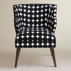 Boasting a mid-century-modern-inspired silhouette, our plush, custom-made accent chair is handcrafted in the U.S.A. of solid pine with bold black and white dot-patterned cotton upholstery.