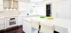 Premier EuroCase | Reflekt High Gloss used in modern white kitchen in San Jose, CA