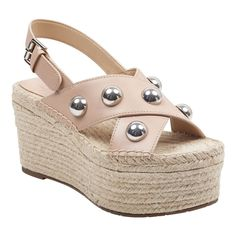 4272739a1275 ... wedge.  MarcFisher  MarcFisherLTD. See more. An adjustable slingback  strap and large bold studs complete the Rella sandal that features criss-