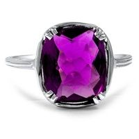 This serene 18K white gold Art Deco reproduction piece showcases a deep purple, oval-shaped amethyst. Intricate hand engraving on the shank features an exquisite nature-inspired design. Milgrain details add to the idyllic look of this ring (Amethyst approx. 1.05 total carat weight).