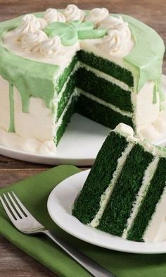 Celebrate with this Green Velvet Layer Cake! Chocolate flavored cake sandwiched with rich cream cheese frosting and topped with white chocolate garnish and a green fondant shamrock. Chocolate Garnishes, Chocolate Flavors, Cake Chocolate, White Chocolate, Great Desserts, Köstliche Desserts, Delicious Desserts, Holiday Desserts, Holiday Baking