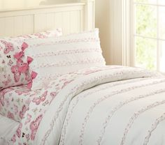 Soo.... I know I said I wasn't going to get pink for my next bedspread, but... this is SO CUTE! And the bows on the pillow shams!  AHH!  I wouldn't get the butterfly sheets, don't worry... And yes, this is from PBKids... I'm a child, apparently!