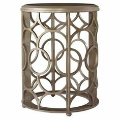 """Showcasing an openwork design and round silhouette, this contemporary end table adds Art Deco-inspired appeal to your living room or master suite.  Product: End tableConstruction Material: Poplar woodColor: MetallicFeatures:  Openwork designArt Deco-inpsired designRound silhouette Dimensions: 26"""" H x 20"""" Diameter"""