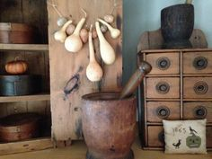 gourds, old pantry boxes, mortars and spice box. cross stitch pinkeep by Tina Woltman.
