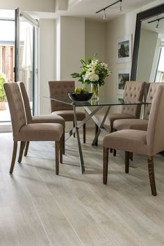 Flooring for all common areas. This light laminate flooring (White Wash Oak Planks by Quick-Step) brightens this beautiful neutral toned dining room. Flooring, Dining Room Decor, Decor, Hardwood Floors, Home, Laminate Flooring, Laminate Flooring Colors, House Flooring, Home Decor