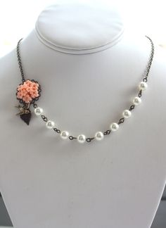 Summer Dreams. A Peach Flower Bouquet, Flying Bird, Ivory Pearls Necklace. Bridesmaid Necklace. Gifts for Maid of Honor.. $29.50, via Etsy.