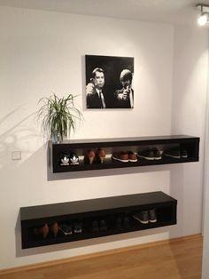 IKEA LACK tv unit used as a shoe holder.  Great idea for a closet.
