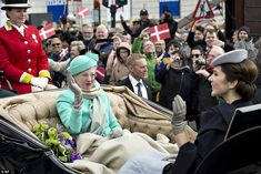 Enjoying the ride: Margrethe and Mary sat opposite each other during the procession along...