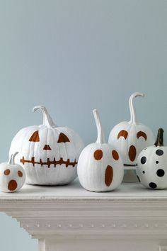 Paint your pumpkins. Paint—don't carve—your pumpkins for a chic and simple style.