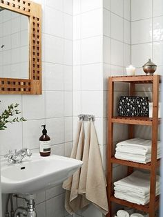 Small Bathroom Pict - Open Shelving Unit and Pedestal Sink   fbeed.com.  This tiny and small bathroom is made functional by the use of a pedestal sink, and very functional wooden open cabinet.