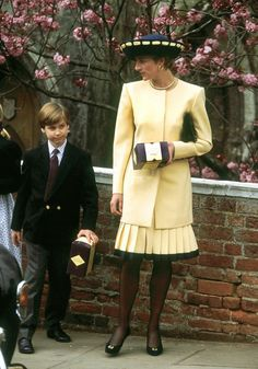Princess Diana and her son Prince William leaving Windsor Chapel after the traditional Easter service, April 1992. They are both holding Easter eggs that had been given to them. Photo courtesy of Getty Images.