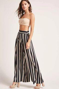 A pair of chiffon woven pants featuring a wide-leg design, pleated front, high waist, and a concealed back zipper.<p>- Matching top available.</p>