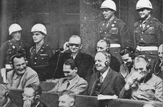 Laugh with Hermann Goering (left) and Rudolf Hess (next to Goering) at the Nuremberg Trials. https://sites.google.com/site/warrenbellauthor/
