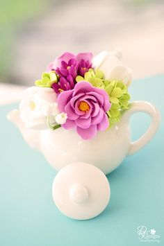 Just created this new mini teapot of purples, greens and whites - lily of the valley, ranunculus, garden roses, hydrangeas and hyacinth.