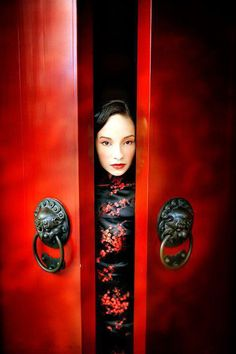 .Love this photo of beautiful red doors and woman in traditional fashion.