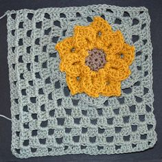 Small crocodile flower granny square---for future blanket project with brightly colored flowers, white background, grey outlines