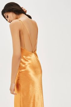 Option for a bold party look with this '90s style ruched front slip midi dress. In an eye-catching bronze hue, it comes with elongated straps to the back and a sultry split to the front centre.