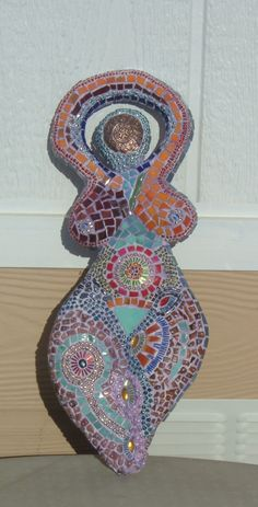 My art. Hand made clay base, covered with mosaic. Materials used: glass, beads, copper. For sale. $150.