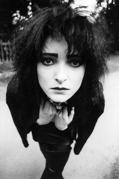 a very cute photo of Siouxsie <3 <3 <3 awww she looks like a needy cat.