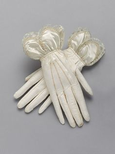 1833 pair of white leather gloves with cream satin and lace scalloped cuffs