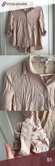 Beige blouse Never worn beige blouse. Needs Some ironing! It'll be great with black leggings or pants! The back has lace detailing! Has rolled up Buttoned sleeves! Inside lace has slight pink mark which I didn't notice when I bought it. Tops Blouses