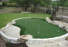 Unique green situated in raised stone barrier, integrating natural stone features on border. Features multiple holes and approaches, plus full sand trap. Home Putting Green, Artificial Putting Green, Outdoor Putting Green, Indoor Outdoor, Outdoor Living, Outdoor Games, Outdoor Stuff, Outdoor Play, Golf Green