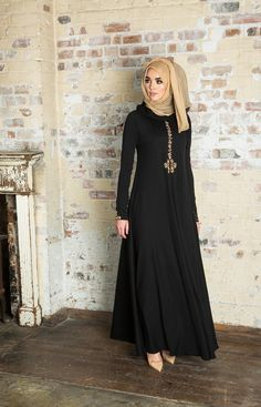 Simple black Abaya, with front detail. NEROLI ABAYA - Beautifully crafted Abaya with detailed embroidery on the placket, cuffs and back, the embroidered buttons are made by hand & showcased on the back & cuffs, an exquisite piece for special occasions. Hijab Fashion 2016, Abaya Fashion, Modest Fashion, Muslim Dress, Hijab Dress, Islamic Fashion, Muslim Fashion, Modest Wear, Modest Outfits