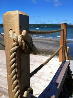 The Refresh Shop- Rope railing tied to horn cleat. Beachy perfection.