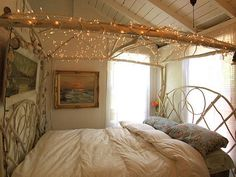 boho bedroom with fairy lights above the bed. <3___<3
