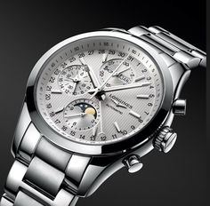 Oh my – Longines Conquest Classic Moonphase. 42mm. Hours, minutes, small second and 24-hour indicator at 9 o'clock, day of the week, month and moon phases. Date indicated by the half-moon central hand.