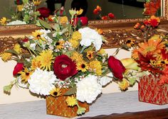 """Fall arrangement with Black-eyed Susan flowers and red roses. Made with our """"natural-touch"""" botanical flowers."""