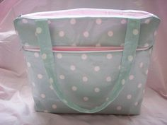 A Handmade Bag in Cath Kidston Eau De Nil Oilcloth and a Pink Lining.  Internal Pockets, and a large external Pocket.