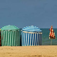 love these parasol tents in Deauville, France