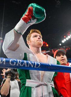 Canelo Alvarez waves to boxing fans before taking on Floyd Mayweather Jr