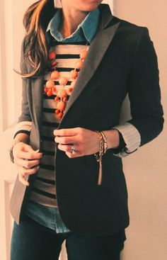 Chambray button up, striped blouse, orange statement necklace, black blazer, gold jewelry, side pony