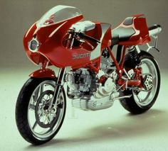 The 2000 MY Ducati 900MHE has, at its heart, an air-cooled, four-stroke, 904cc, 90-degree V-Twin desmodromic engine paired to a six-s...