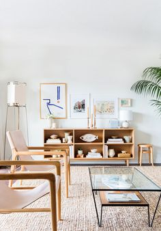 This week, interiors featuring Japanese-inspired minimalism, rattan-covered walls, abstract art, '70s-style sofas, and a trompe l'oeil staircase to nowhere.