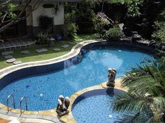 We've listed some cool swimming pool design ideas that are so easy to replicate. Go on. Check them out and gather some inspiration for your next swimming pool renovation project. [Backyard Pool Landscaping, Pool Remodel Ideas, Pool Remodel On A Budget] #BackyardLandscapeIdeas #PoolDesignIdeas #PoolIdeas