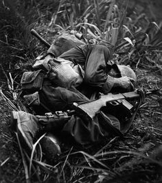 U.S. Infantryman Terry Moore taking shelter during Battle of #Okinawa in May, 1945. (W. Eugene Smith photo). #WWII