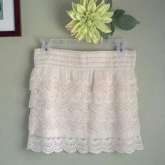 """Crochet Skirt Super cute crochet skirt with liner attached. Elastic waist measures approx 15"""" across unstretched, length approx 14"""". Semi sheer. NWOT. Excellent condition! Polyester body. Liner polyester/spandex. Dry clean.  No trades. No modeling. Delia's Skirts Mini"""