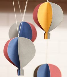 Use cardstock to create this hot air balloon mobile.