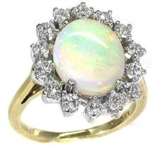 Cabochon Oval Opal 0.65ct Diamond Gold Ring