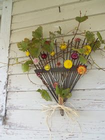 Metal rake recycle up to a wreath - seasonal flowers, outdoor gate or garden wreath