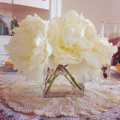 Shallow square vase with faux peonies