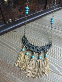 With bronze pendant, chain and turquoise howlite stone beads. Currently sized at 35 inches. the size can be adjusted for any fit with notes to seller at checkout. All of my jewelry is lead and nickel