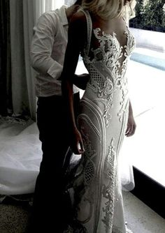 Even if you don't like plunging necklines, youmust admit that this gown is gorgeous! It's designed by J'Aton Couture and fully hand embroidered. The gown was entirely sculptured to the bride's body.